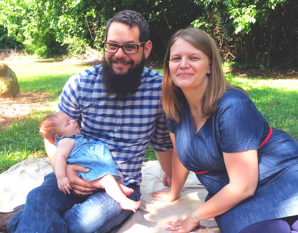 Tim Denson relaxes with his wife, Jenny, and their daughter, Sarah.
